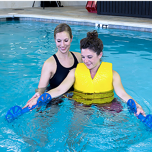 Patient working with therapist in swimming pool