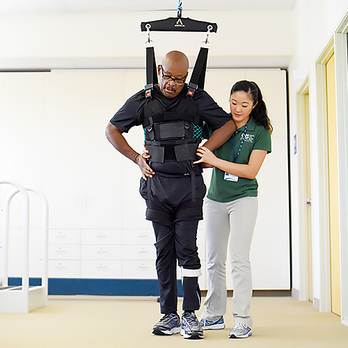 Patient using the ZeroG Gait and Balance system